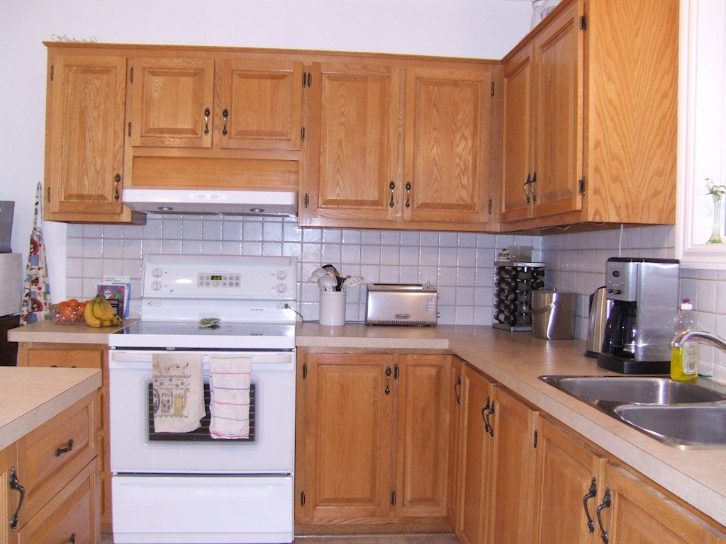 Armoires de cuisine en ch ne veines - Teindre armoire de cuisine ...