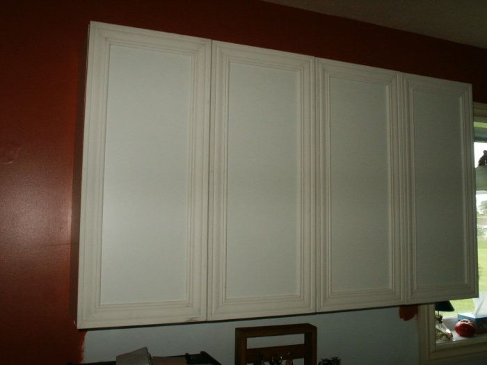 Restauration d 39 armoire de m lamine for Decoration porte avec moulures